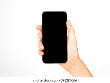 Girl holding smart phone in hand, black screen