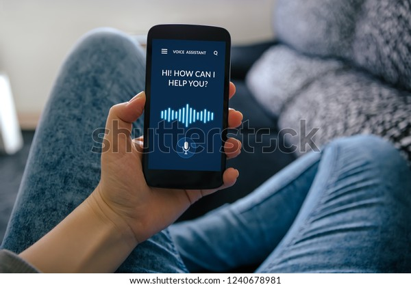 Girl holding smart phone with voice assistant concept on screen. All screen content is designed by me