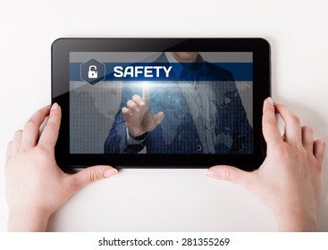 Girl holding a tablet pc which a man presses the virtual screen with text safety. Technology, business, internet, concept.