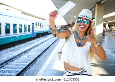 The girl is holding a train ticket