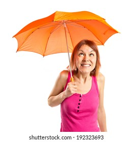 Girl holding an umbrella over white background