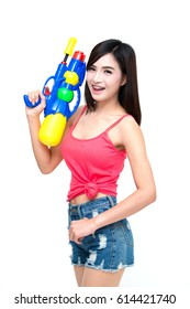 Girl holding a water gun and happy playing. On Songkran Festival Day, isolated on white studio background.
