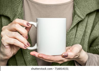 Girl  holding white mug. Mockup for Halloween gifts design.