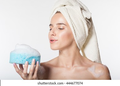 Girl is holding wisp with white foam