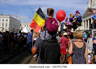 A girl holds a belgian flag on Belgian national day in Brussels, Belgium July 21, 2019.