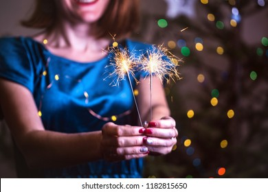 girl holds bengal lights - happy christmas and merry holidays
