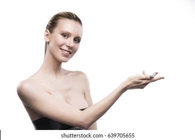 the girl holds blank space over a hand on a white background.