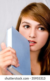 girl holds the book