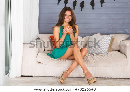 4033b173873 Girl Holds Cup Hands Sitting On Stock Photo (Edit Now) 478225543 ...