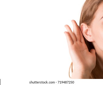 Girl holds ear to listen better sound isolated white background