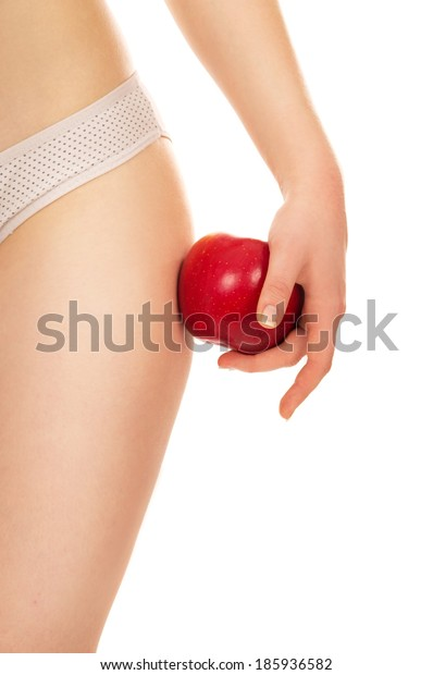 girl holds on hips apple isolated on white background