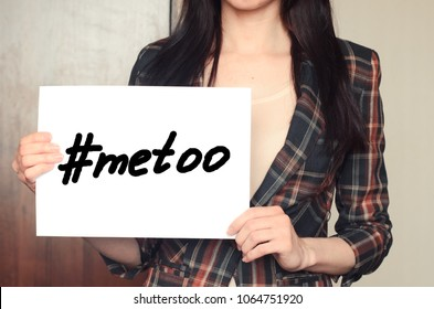 Girl holds a paper sheet with hashtag me too against harassment and sexual discrimination