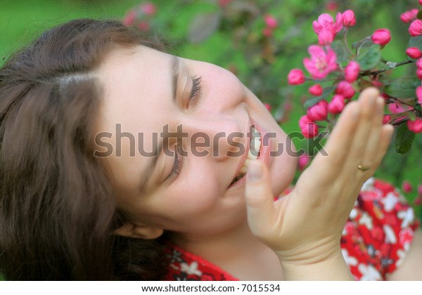 Girl holds pink flowers and smile - very cute portrait