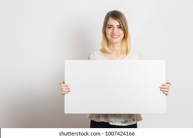 girl holds a white sheet in hands, an office worker shows a blank sheet