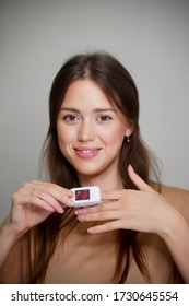girl at home with a pulse oximeter on her finger