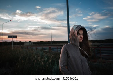 girl in the hoodie on the bridge