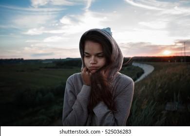 girl in the hoodie on the bridge