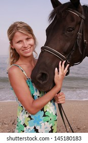 a Girl with a horse by the sea