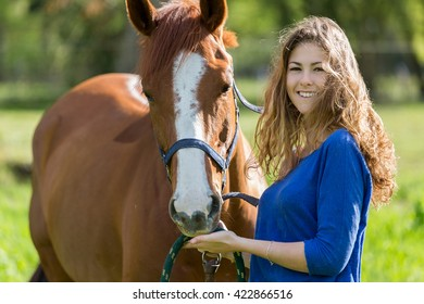 Girl and horse in field