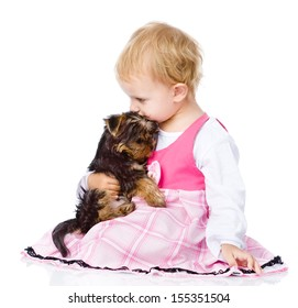 girl hug a little Yorkshire Terrier  puppy. isolated on white background