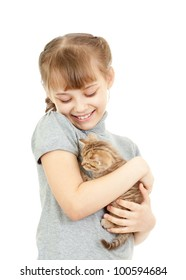 Girl hugging with British kitten isolated on white