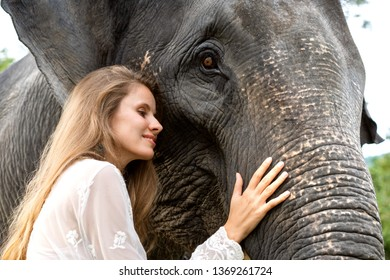girl hugging an elephant in the jungle