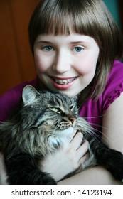Girl hugging her kitty