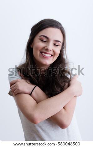 girl hugging herself の写真素材 今すぐ編集 580046500 shutterstock