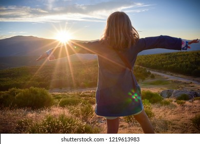 Girl hugging a sunset. Serenity and peace
