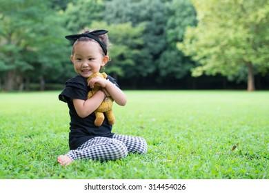 Girl hugging a teddy bear