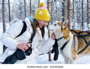 Girl and Husky dog in Rovaniemi, Lapland of Finland