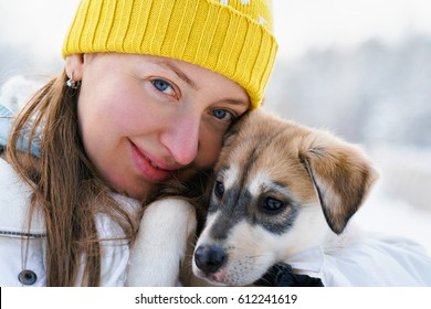 Girl and Husky puppy in Rovaniemi, Lapland, Finland