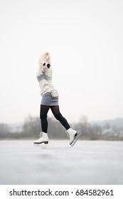 Girl Ice Skating in Oslo, Norway