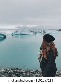 Girl in Icelandic glacial lagoon