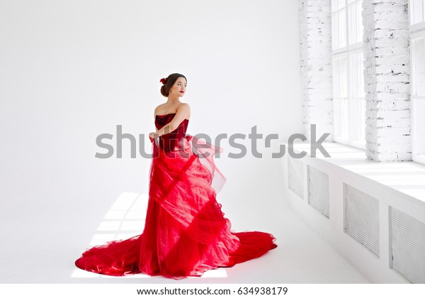 The girl in the image of Carmen. Beautiful girl in a red dress