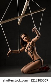 Girl in the image of marionette in the dark