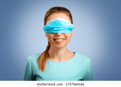 The girl incorrectly put on a protective mask. The nurse teaches you to put on a mask. Protection from disease and virus. Disposable mask. Self-isolation protection. The woman doctor smiles.