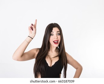 girl indicated empty space with finger, light background