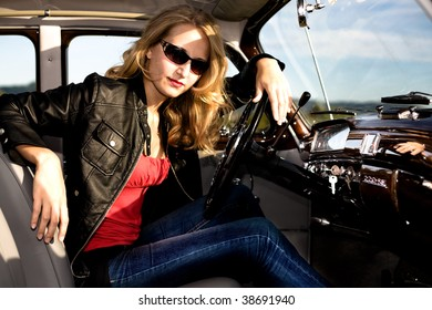 Girl inside of Post-War classic car
