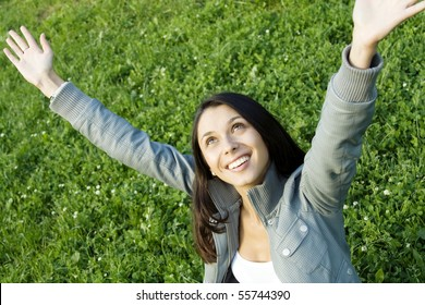 Girl in jacket. It has lifted hands upwards towards to the sky and a wind