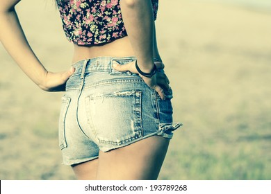 Girl in jeans shorts. Colorized photo.