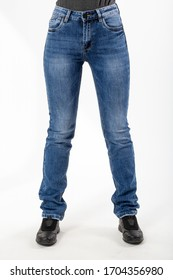 girl in jeans shows jeans on a white background close-up, blue jeans