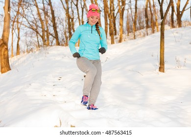 Girl jogging in freezing temperature. How to prepare for exercising in winter, fitness health nature fashion concept