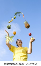 Girl juggling fruits and vegetables