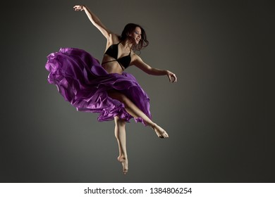 girl in a jump in a gray skirt
