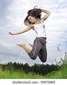 girl jump on field