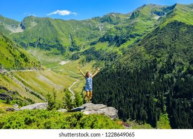 Girl in the jump. Transfagarasan mountain road.