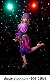 Girl jumping dancing confetti