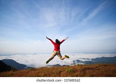 Girl jumping morning mist.