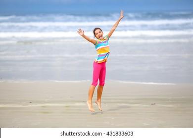 Girl jumping on the beach